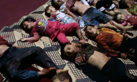 The bodies of children whom anti-government protesters say were killed by government security forces lie on the ground in Huola, near Homs May 26, 2012. (Photo: Reuters)